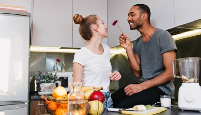 loving-couple-t-shirts-flirting-kitchen-husband-gives-his-wife-beautiful-flower-happy-faces-nice-gift-healthy-eating-happy-pair_197531-1615