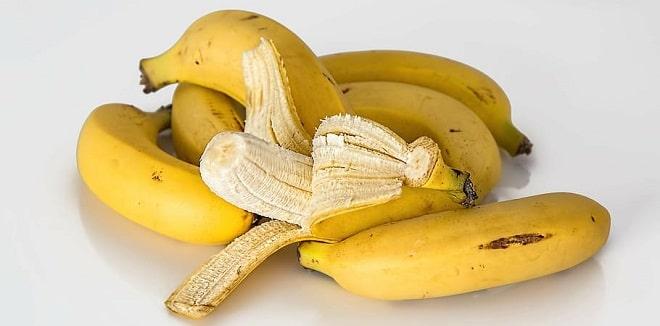 ripe bananas on a white counter