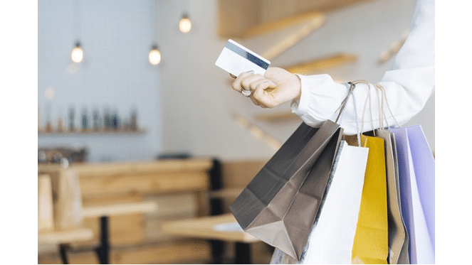 shopping top retail lady holding credit card and shopping bags freepik