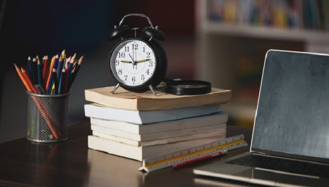 book-laptop-pencil-clock-wooden-table-library-education-learning-concept jcomp