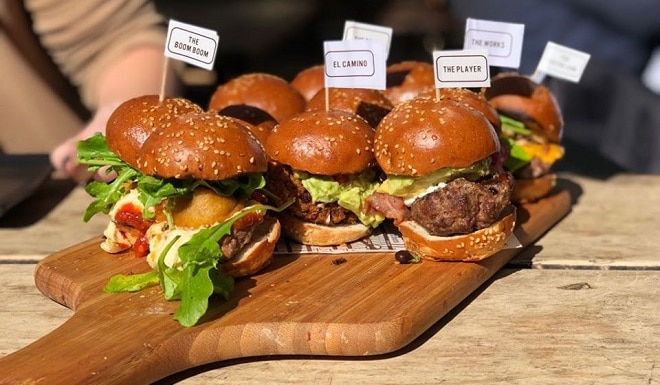 hudsons burger joint burgers on a wooden board