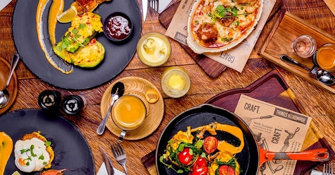 craft restaurant parkhurst aerial view of table filled with food